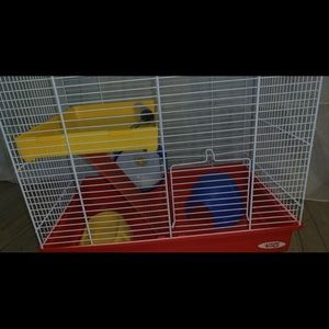 2 slightly used hamster cages and hamster balls